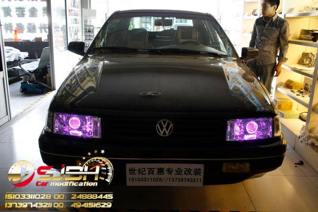 黑色桑塔纳2000改装升级版q5双光透镜,世纪百惠专业灯光升级!